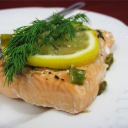 Garlic Salmon Recipe - A large salmon filet, steamed in foil and cooked either in the oven or barbecue.  It's seasoned with minced garlic, fresh baby dill, lemon slices, fresh ground pepper and green onions.