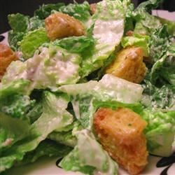 Caesar Salad Supreme Recipe - The garlic croutons that top this classic salad are wonderful, as is the anchovy-infused, very creamy dressing.