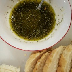 Bread Dipping Oil Recipe - Olive oil is mixed with several dried herbs and lemon juice to make a simple and tasty dip for bread.