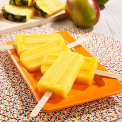 Mango Pineapple Ice Pops Recipe - Frozen fruit is blended together with Reddi-wip, pineapple juice and coconut extract for refreshing pineapple mango ice pops to make any time.