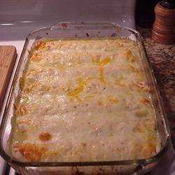 Honey-Lime Enchiladas Recipe - Spicy-sweet, cheesy chicken enchiladas are baked in a casserole and served hot.