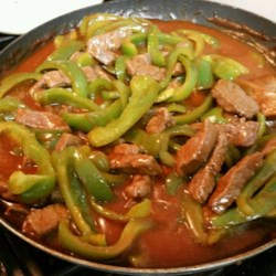 Chinese Pepper Round Steak Recipe - Stir-fry beef strips with green peppers, and serve in a savory tomato sauce for an easy supper that's on the table in an hour.
