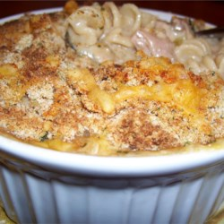 Tuna Noodle Casserole III Recipe - A quick layered casserole with tuna, cheese and egg noodles.  Experiment with different cheeses and soups to develop your own family recipe! For variety, add chopped celery, peas and/or carrots.