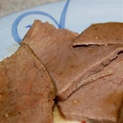 Roast Beef with Coffee Recipe - You can do this in the oven or in a slow cooker for 6 to 8 hours. The meat is simmered with garlic cloves and coffee.