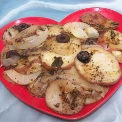 Potato Pouches Recipe - Sliced red potatoes are arranged with fresh herbs and spices in a foil pouch and baked in an oven or on a grill.  This versatile method can also be used to cook other vegetables, such as zucchini, winter squash or tomatoes.