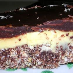 Nanaimo Bars I Recipe - These are a totally sinful concoction containing more calories than one would care to   count.  A decadent dessert!  Will satisfy any sweet tooth!