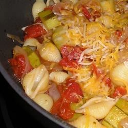 Zucchini and Shells Recipe - Family favorite to use that beautiful summer zucchini! Very simple recipe that tastes great accompanied by garlic bread! Very good for vegetarians, too.