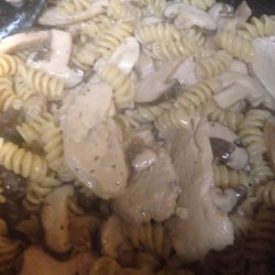 Pasta with Chicken Mushroom Cream Sauce Recipe - Chicken and shiitake mushrooms simmered in a rich cream sauce and tossed with bowtie pasta.