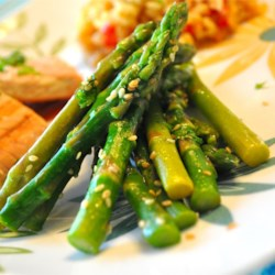 Lemon-Sesame Asparagus Recipe - Toasted sesame seeds, lemon juice and parsley are added to melted butter and drizzled over crisp asparagus.