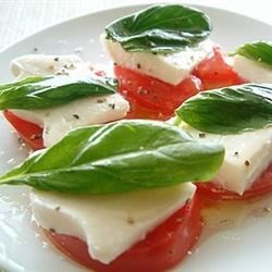 Owen's Mozzarella and Tomato Salad Recipe - So easy, looks great, and tastes fabulous. Plump tomatoes are topped with thick slices of cheese, a drizzle of good olive oil, and fresh basil.