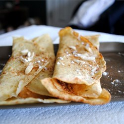 Norwegian Pancakes - Pannekaken Recipe - My Norwegian grandmother made this for us as a treat, and it continues to be a favorite my mother makes for my kids.  Very easy and versatile.  Serve rolled like a crepe with syrup or jam.  Can also be a dessert stuffed with a sweetened cream cheese and lingon berry mixture.