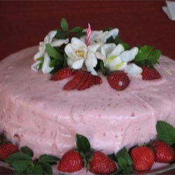 Strawberry Dream Cake II Recipe - A white cake mix is livened up with mashed strawberries and strawberry-flavored gelatin, then baked in three 9-inch pans. It is then frosted with Strawberry Cream Cheese Frosting.