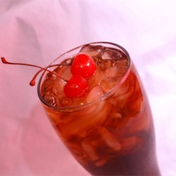 Pirate's Last Call Recipe - Even Captain Hook would love this cocktail with its cherry cola and rum flavors poured into a tall frosty glass.