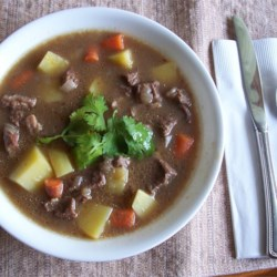 Beef Stew IV Recipe - Browned beef is seasoned with paprika and simmered with onions, carrots, potatoes and frozen corn kernels.