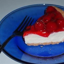 Cherry Cream Cheese Pie Recipe - This pie is heavy on flavor but light on calories. Light cherry pie filling and fat-free condensed milk are used to create this very creamy cheesecake crowned with cherries.