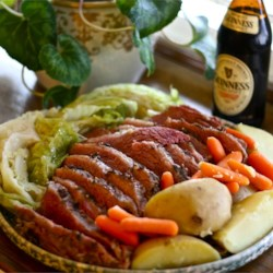 Corned Beef and Cabbage I Recipe - This traditional Irish dish is the centerpiece for St. Patrick's Day. Corned beef and cabbage simmer with potatoes and carrots for a hearty dinner.