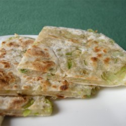 Green Onion Cakes Recipe - These savory green onion pancakes make a great accompaniment to grilled meat or chicken.