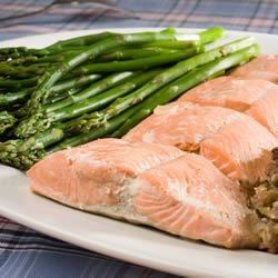 Poached Salmon I Recipe - This salmon is poached with marvelous ingredients like onions, carrots, celery, and wine. Don't pass this one by! Hollandaise sauce is the perfect accompaniment for this dish.