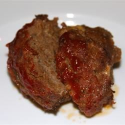 Cajun Style Meatloaf Recipe - Andouille sausage and complex seasonings enliven this ground beef meatloaf. The oven temperature is raised during the last 35 minutes of baking for a little surface crunch.