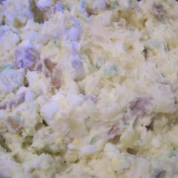 Mom's Mashed Potato Salad Recipe - Light and fluffy mashed potatoes make a deliciously light and fluffy potato salad. With hard cooked eggs, sweet pickles, and sweet onion, this dish is sure to be a summer favorite.