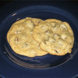 Orange Chocolate Chip Cookies Recipe - A happy marriage of orange and chocolate. Just say 'I do!' and reward yourself with these orange-accented chocolate chip cookies with pecans.
