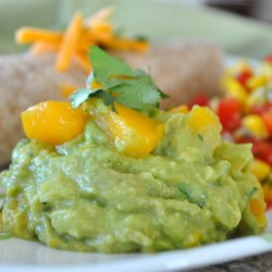 Mango Guacamole Recipe - Try this sweet, tangy, and spicy guacamole with serrano chile peppers, cilantro, and mango as a nice accompaniment to tortilla chips on a warm summer day.