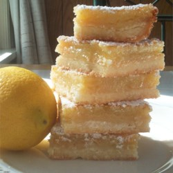 Lemon Square Bars Recipe - A traditional lemon bar. These can be dressed up by adding a layer of meringue too!