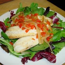 Balsamic Baked Tilapia Recipe - Balsamic vinegar adds a subtle sweetness to the onions and peppers that top these tasty tilapia fillets.  A sprinkle of blue cheese brings the whole dish together.