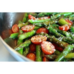 Asparagus Side Dish Recipe - This side dish involves steaming asparagus and grape tomatoes and topping with olive oil and Parmesan cheese.