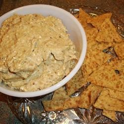 Malidzano Eggplant Spread Recipe - Mediterranean eggplant spread... an unusual blend of ingredients that come together in wonderfully delicious way! Spread on pita chips or baguette slices.