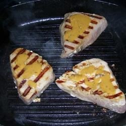 Grilled Tuna Steaks with Dill Sauce Recipe - A simple sauce made with dill and mustard tops grilled tuna steaks in this simple recipe for the grill.