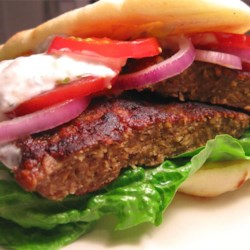 Gyros Burgers Recipe - This is a Greek/American lamb and beef mixture version of the traditional Greek pork or lamb Gyros (or Gyro). Serve on warm pita bread with tzatziki sauce, and thinly sliced onion, tomato and lettuce.