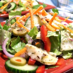 Spicy Italian Salad Recipe - A marinated artichoke dressing and two types of olives are the highlight of this zesty romaine lettuce salad.