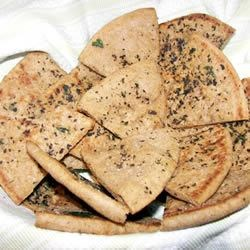 Pita Chips Recipe and Video - These fresh-from-the-oven triangles--pre-brushed with olive oil and herbs--have a warm and crunchy warm snap that you just can't get from a store bought bag.