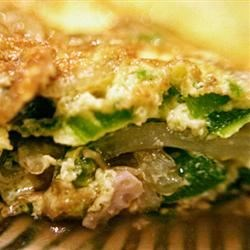 Egg Foo Young Recipe - Fresh veggies and ham are sauteed with ginger, then folded into beaten eggs and cooked up like little omelets.  Use bacon or chicken, or any meat you prefer.  Serve with soy sauce, if desired.