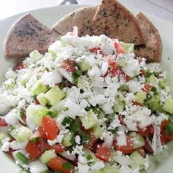 Shirazi Salad topped with feta & served with pita triangles