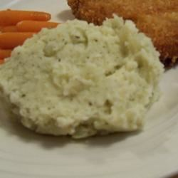 Yummy Pesto Mashed Potatoes Recipe - Simply by adding pesto to boiled potatoes then mashing, adds a delicious alternative with a hint of colour to the usual mash - and guess what - the kids just love it too! Try using different kinds of pesto. You could also add some sun-dried tomatoes and top with a little grated cheese and black pepper.