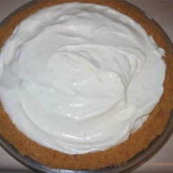 World's Best Key Lime Pie Recipe - Make and eat this delicious and easy pie within about an hour.  Condensed milk, key lime juice and whipped topping are combined, poured into a graham cracker crust and chilled.
