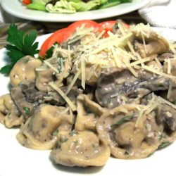 Absolutely Fabulous Portobello Mushroom Tortellini Recipe - Delicious portabello mushrooms cooked with wine, garlic and parsley enhances a creamy rich and ready-made Alfredo sauce. Serve over cheese tortellini for a quick yet impressive dish.