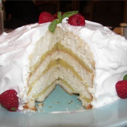 Lemon Layer Cake Recipe - An old fashioned lemon cake recipe.  It is usually made up of 3 to 6 white cake layers with a cooked lemon filling between the layers and iced in Seven Minute Frosting.