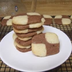 CheckerBoard Cookies I Recipe - Use a trick in this recipe to make cookies that resemble a section of a black-and-white checkers or chess board.