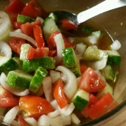 Tomato Cucumber Onion Salad Recipe - Tomato, cucumber, and onion in a simple red wine vinegar and olive oil dressing is a quick and easy salad.