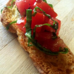 Bruschetta I Recipe - Fresh tomatoes, parsley, chives, garlic and basil create this beautiful, tasty dish.  Add balsamic vinegar if you like.  Serve on toasted French bread with pesto, or enjoy it all by itself.