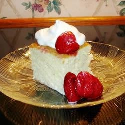 Tres Leches Cake Recipe - The three milks in this egg rich Mexican cake are used to macerate and frost this high, single-layer cake decorated with Maraschino cherries.