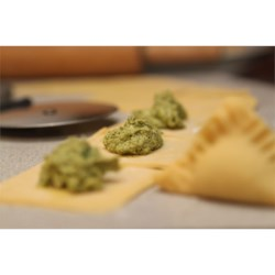 Chicken and Spinach Ravioli Recipe - A delicious combination of chicken and spinach make a wonderful Italian meal. Make sure to have plenty of freshly grated Asiago cheese to top these ravioli.