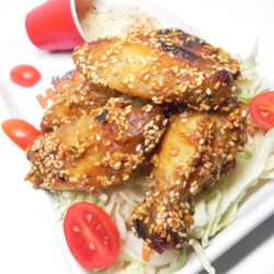 Sesame Wings Recipe - The same old honey mustard coating gets a big lift from lemon, curry and garlic in these baked chicken wings covered with sesame seeds.