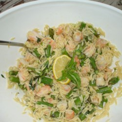 Orzo and Shrimp Salad with Asparagus Recipe - This is a dish that goes together quickly, can be doubled easily, and looks beautiful! Orzo , shrimp and fresh asparagus tossed with a light olive oil, lemon and basil dressing. Perfect for a warm weather picnic. Can be served chilled, at room temperature, or heated!