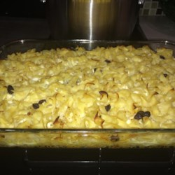 The Best Ever Classic Jewish Noodle Kugel  Recipe and Video - Egg noodles are baked with applesauce and a hint of vanilla in this classic noodle pudding.