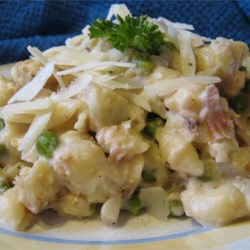 Tuna Noodle Casserole II Recipe - There's nothing like a warm and comforting casserole to soothe an edgy day. Combine egg noodles with a rich blend of cream of mushroom soup, evaporated milk, canned tuna, American cheese and chopped onion. Bake with a crust of potato chips and paprika.