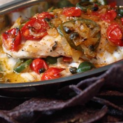 Veracruz-Style Red Snapper Recipe and Video - Red snapper is cooked with a Mexican-inspired mixture of tomatoes, jalapeno peppers, olives, and oregano, for a light but flavorful meal.